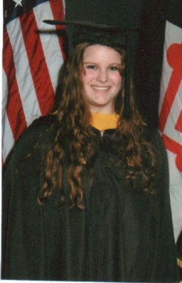 graduation picture.. smiling, but not smiling