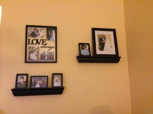 New shelving and frames for the living room wall