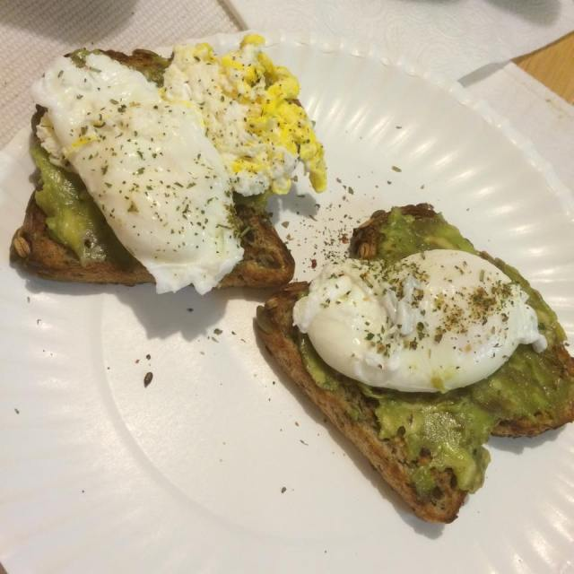 Sprouted grain toast with guacamole and poached eggs